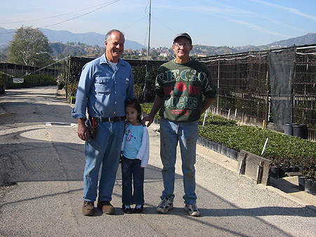 Tom Nuccio, Jim Nuccio and Elizabeth Panchul. Nuccio's Nurseries, Altadena, California, December 13, 2003.